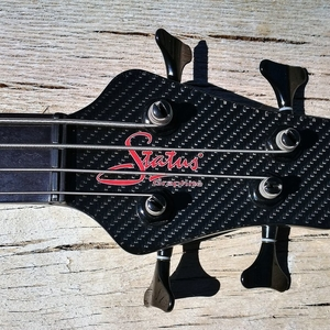 STATUS Electro 4 lined fretless with bridge pickup added by SP Custom.